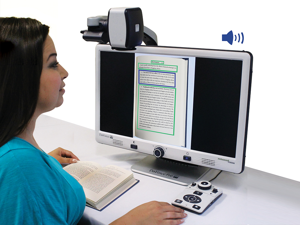 woman using DaVinci Pro to read a book